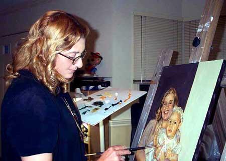 yoyita painting a portrait